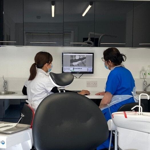 dentist looking at xray dentist in hitchin uai